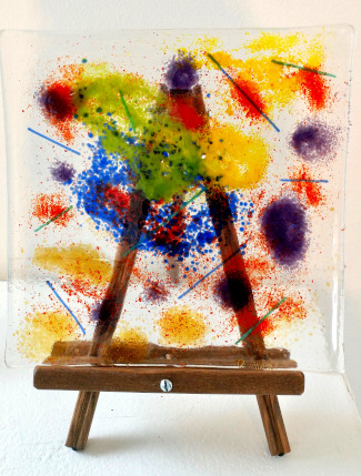 Glass square with splattered paint, on a small easel