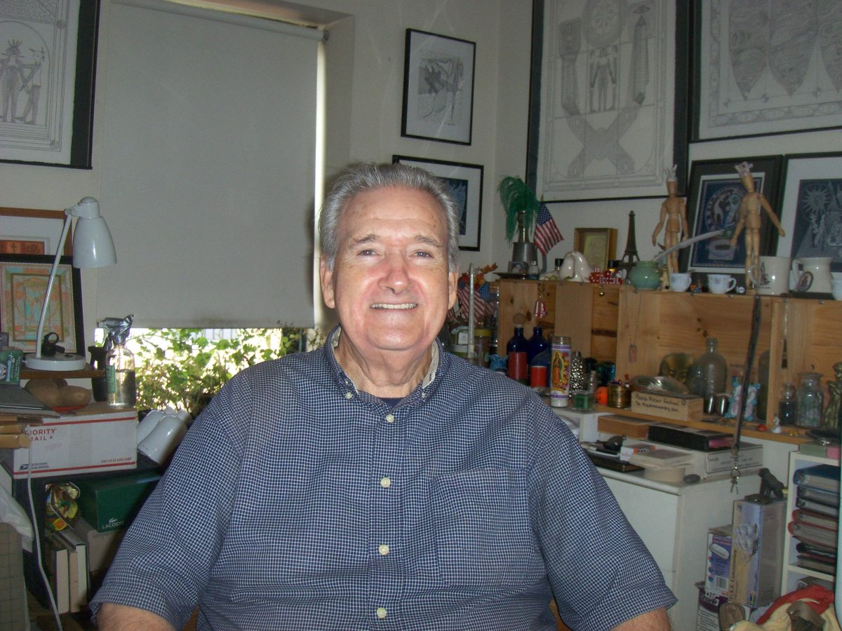 A photo of Bill Kinnear, an older light skinned man with gray hair wearing a blue shirt and smiling for the camera.