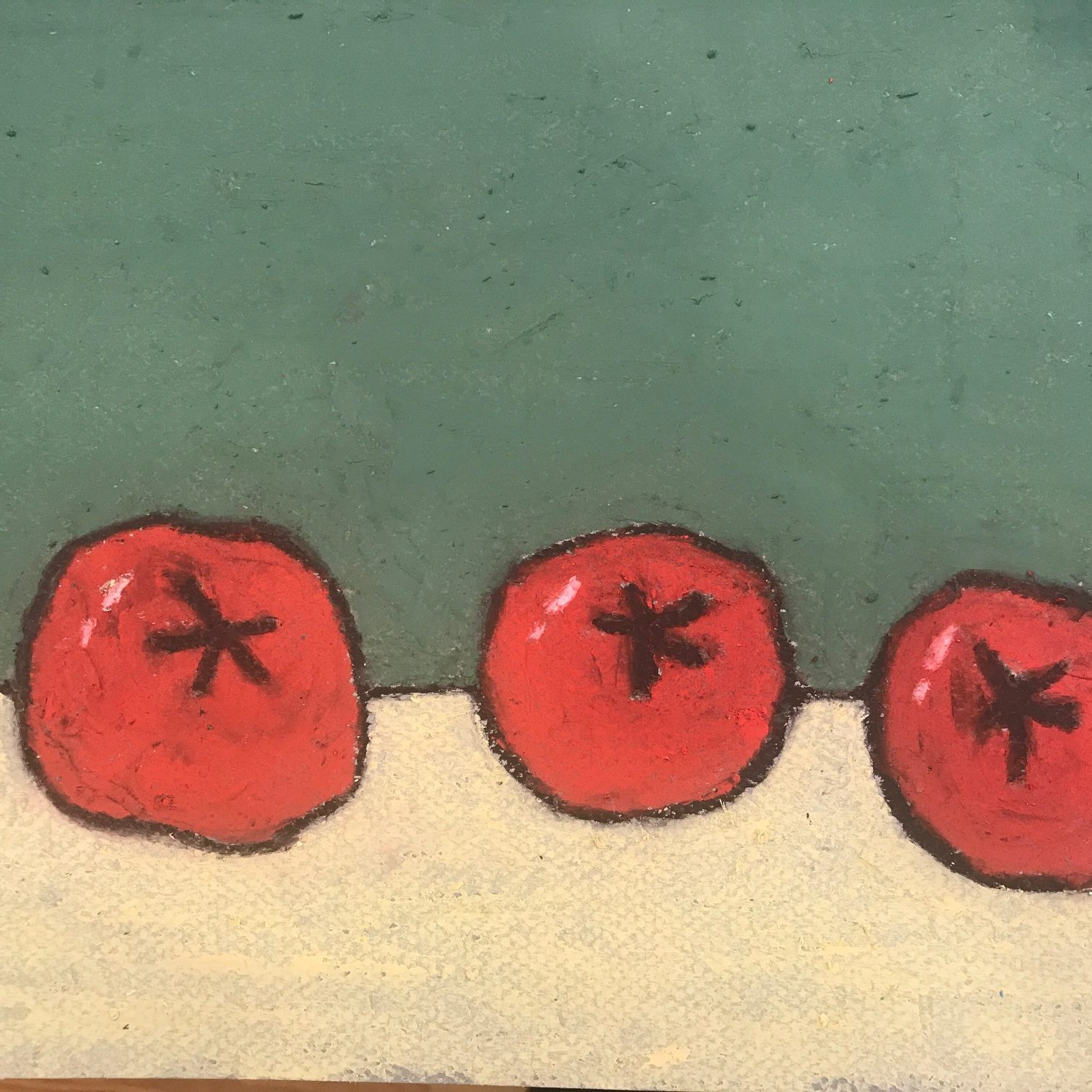 Oil pastel of three red tomatoes on a table with green background