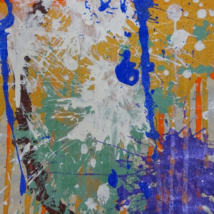 Silver canvas with drips of orange and splashes of purple, white, turquoise, and blue in the forefront.
